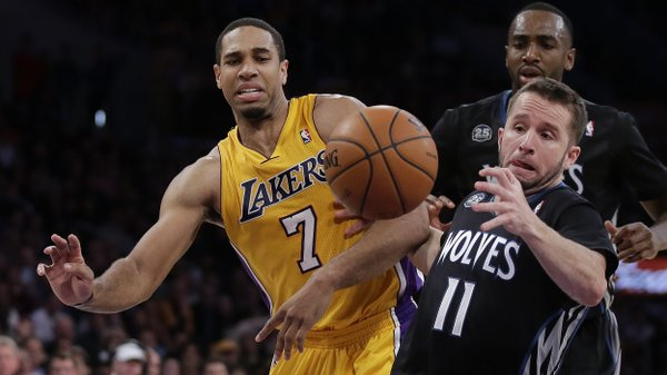 Los Angeles Lakers forward Xavier Henry, left, battles Minnesota Timberwolves guard J.J. Barea for a loose ball during the second half of an NBA basketball game in Los Angeles, Friday, Dec. 20, 2013. (AP Photo/Chris Carlson)