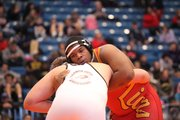 Lawrence High senior Alex Jones, 285 pounds, wrestles against Garden City High's Montana Fuller on Saturday, March 1, 2014, in the 6A state championship. Jones won by a 4-1 decision.
