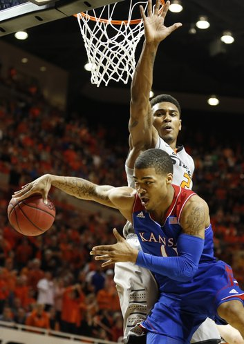 Kansas guard Frank Mason tries to hook a pass around Oklahoma State forward Le'Bryan Nash during the second half on Saturday, March 1, 2014 at Gallagher-Iba Arena in Stillwater, Oklahoma.