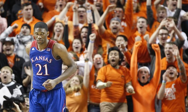 The Oklahoma State student section explodes behind Kansas center Joel Embiid following a bucket by the Cowboys late in the second half on Saturday, March 1, 2014 at Gallagher-Iba Arena in Stillwater, Oklahoma.