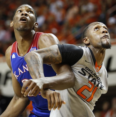 Kansas center Joel Embiid and Oklahoma State forward Kamari Murphy tangle for position during the first half on Saturday, March 1, 2014 at Gallagher-Iba Arena in Stillwater, Oklahoma.