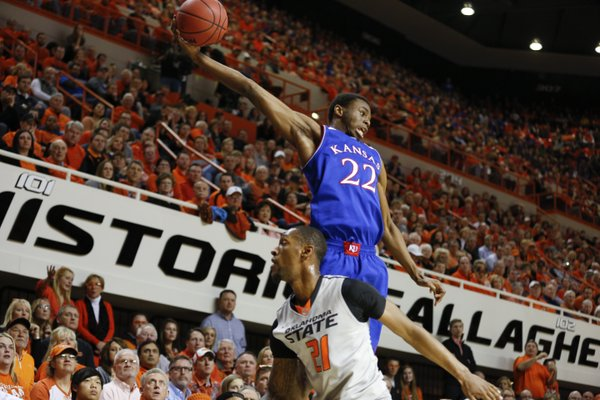 Kansas guard Andrew Wiggins tries to save a loose ball from going out-of-bounds over Oklahoma State forward Kamari Murphy during the first half on Saturday, March 1, 2014 at Gallagher-Iba Arena in Stillwater, Oklahoma.