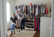 Max Greenwood turned a second bedroom in his home into a giant walk-in closet for his fiancee Emily Kuykendall. A clothes rack system and some salvaged shelves, offering slots for pairs of shoes, runs the length of one wall. A vanity table and mirrors and a dresser are along the other walls.