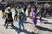 Colorful characters march in the annual Mardi Gras parade.
