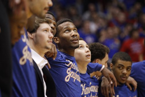 Kansas guard Wayne Selden hooks arms with his teammates as they sing the Alma Mater prior to tipoff against Texas Tech on Wednesday, March 5, 2014 at Allen Fieldhouse.