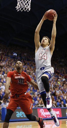 Kansas guard Brannen Greene comes in for a jam past Texas Tech forward Jaye Crockett during the second half on Wednesday, March 5, 2014 at Allen Fieldhouse.