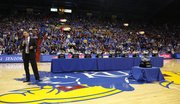 Kansas head coach Bill Self addresses the fieldhouse next to the program's ten consecutive conference titles following the Jayhawks' 82-57 win over Texas Tech.