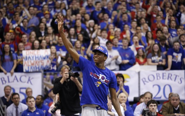 Kansas guard Andrew Wiggins, who most likely will enter the NBA Draft waves to the fieldhouse prior to the senior speeches on Wednesday, March 5, 2014 at Allen Fieldhouse.
