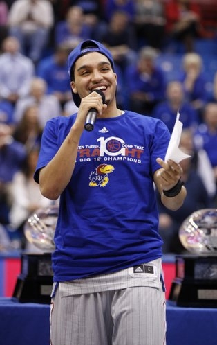 Kansas senior guard Niko Roberts smiles as he delivers his senior speech on Wednesday, March 5, 2014 at Allen Fieldhouse.
