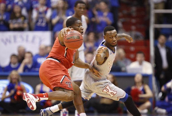 Kansas guard Naadir Tharpe takes a swipe at a ball handled by Texas Tech guard Randy Onwuasor during the first half on Wednesday, March 5, 2014 at Allen Fieldhouse.