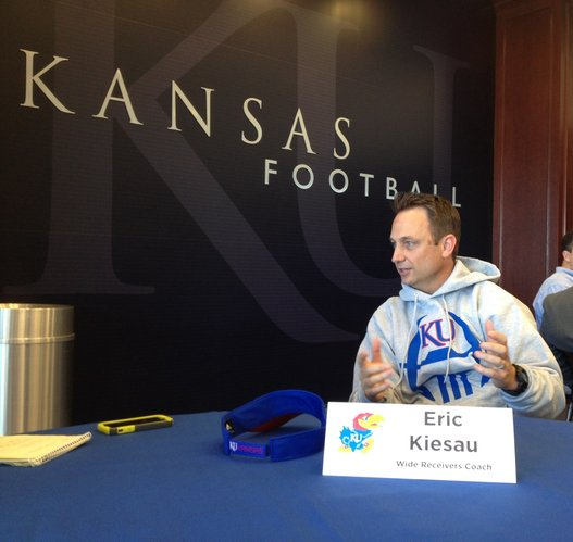 KU wide receivers coach Eric Kiesau talks with the media about what brought him to Kansas and his excitement about the start of spring practices, which kicked off Thursday, March 6.