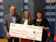 Quail Run second grade teacher Paula Barr, center, was named the Lawrence School District's 2013-2014 Elementary Teacher of the Year. The award came with a $1,000 check presented by Superintendent Rick Doll and Ginger Wehner, vice president of Truity Credit Union.