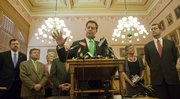 In press conference Friday, Kansas Governor Sam Brownback, flanked by legislators and staff including at right, Senator Susan Wagle, President of the Senate and Attorney General Derek Schmidt discusses the Kansas Supreme Court's ruling on the Gannon vs. State of Kansas.