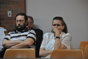Michael and Tammy McCoy, step-father and mother of Kyle T. Flack, 28, Ottawa, who is charged in connection with the killing of three adults and an 18-month-old girl in spring 2013, listen to testimony about how the victims in the Ottawa-area quadruple homicide were killed Wednesday morning in Franklin County District Court, Ottawa. All four victims died as the result of gunshot wounds.
