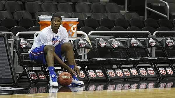 91fdb5d9f3af Kansas center Joel Embiid ties a shoe during practice for the Jayhawks   opening NCAA basketball