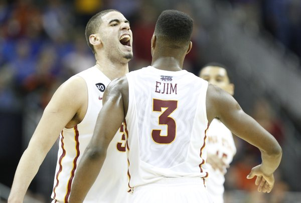 Iowa State forwards Georges Niang and Melvin Ejim celebrate the Cyclones' win over Kansas State on Thursday, March 13, 2014 at Sprint Center in Kansas City, Missouri. They will face Kansas in the semifinal round of the Big 12 Tournament on Friday.