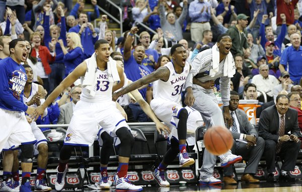 The Kansas bench reacts to a lob dunk by Andrew Wiggins over several Oklahoma State players late in the second half on Thursday, March 13, 2014 at Sprint Center in Kansas City, Missouri.