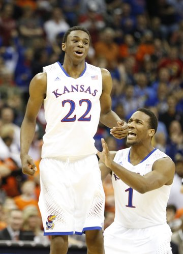 Kansas guard Andrew Wiggins (22) celebrates a dunk with teammate Wayne Selden against Oklahoma State late in the second half on Thursday, March 13, 2014 at Sprint Center in Kansas City, Missouri.