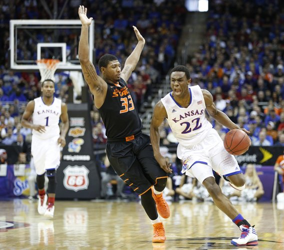 Kansas guard Andrew Wiggins drives against Oklahoma State guard Marcus Smart during the second half on Thursday, March 13, 2014 at Sprint Center in Kansas City, Missouri.