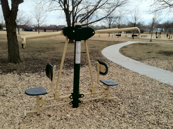 A shoulder and chest workout machine at Deerfield Park's Fitness Zone.