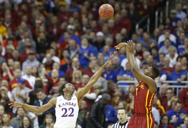 Iowa State forward Melvin Ejim pulls up for a shot over Kansas guard Andrew Wiggins during the first half on Friday, March 14, 2014 at Sprint Center in Kansas City, Missouri.