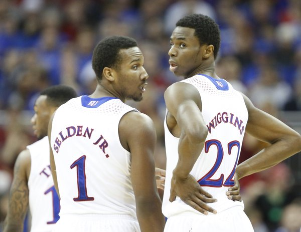 Frustrated, Kansas guard Andrew Wiggins turns back toward an official wanting a foul called during a break along side teammate Wayne Selden in the first half on Friday, March 14, 2014 at Sprint Center in Kansas City, Missouri.