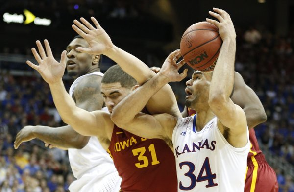 Kansas forward Perry Ellis works his way to the bucket against Iowa State forward Georges Niang during the second half on Friday, March 14, 2014 at Sprint Center in Kansas City, Missou