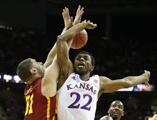 Kansas guard Andrew Wiggins loses the ball as he is fouled by Iowa State forward Georges Niang during the first half on Friday, March 14, 2014 at Sprint Center in Kansas City, Missouri.