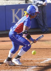 Kansas University senior Ashley Newman puts down a bunt in the Jayhawks' softball meeting with Northern Illinois on Friday, March 14, 2014, at Arrocha Ballpark.