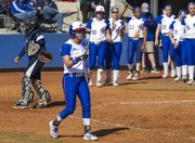 Kansas senior Alex Jones points toward first base at teammate Maddie Stein after a single by Stein drove Jones home for a run during their game against Jackson State, Saturday at Arrocha Ballpark.