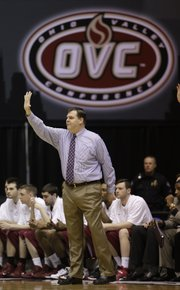 Eastern Kentucky coach Jeff Neubauer signals to his team during the first half of the Ohio Valley Conference tournament championship game on Saturday in Nashville, Tenn. EKU beat Belmont to earn an automatic bid to the NCAAs and will face Kansas University in the second round at 3:10 p.m. Friday in St. Louis.
