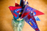 Make your own Jayhawk pennants to wave during the game and after each victory in the NCAA tournament.