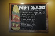 "Richard Gwin/Journal World Photo.Names of those  who have taken on the challenge of eating the ""Everest Challenge"",  at the 23rd Street Brewery."