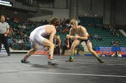 Baker University freshman Bryce Shoemaker, right, wrestles on his way to an NAIA championship on March 8, 2014, in Topeka.