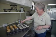Dianna Keller, owner of Dianna's Kitchen, prepares a batch of blueberry muffins on a recent day. The grandmother has found success later in life with a catering business she runs out of her garage.