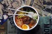 Richard Gwin/Journal World Photo. Ghost Ramen Challenge at Ramen Bowls, 125 E 10th St., a combo of noodles, pork, veggies, an egg and a whole ghost pepper.