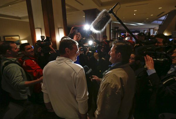 Kansas head coach Bill Self laughs with media members as he stops for questions following the Jayhawks' arrival at the Hyatt Regency hotel at the Arch, Wednesday, March 19, 2014, in St. Louis. The Jayhawks play their first game of the NCAA Tournament on Friday.