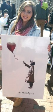 KU student Suhayla Sibaai, who has relatives living in Syria, at a rally in Washington, D.C.