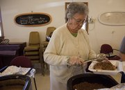 Lawrence Indian United Methodist Church member Esther Harjo dishes up an Indian taco at the church, 950 E. 21st St., on March 14, 2014. The church has held its Indian Taco Sales monthly since the early 1980s.
