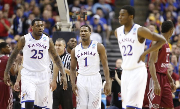 Kansas guard Wayne Selden (1) shows his frustration after being called for a foul during the first half on Friday, March 21, 2014 at Scottrade Center in St. Louis. Also pictured are Tarik Black (25) and Andrew Wiggins (22).