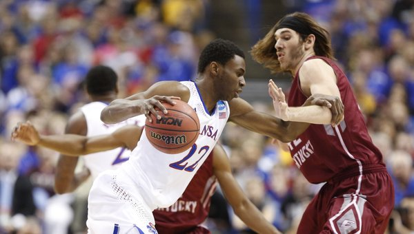 Kansas guard Andrew Wiggins drives around Eastern Kentucky forward Eric Stutz during the first half on Friday, March 21, 2014 at Scottrade Center in St. Louis.