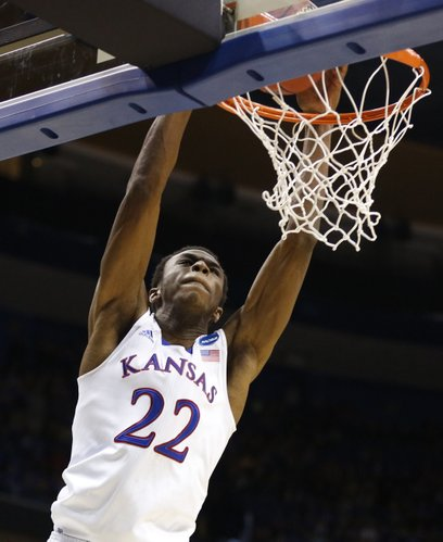 Kansas guard Andrew Wiggins comes in for a dunk against Eastern Kentucky during the second half on Friday, March 21, 2014 at Scottrade Center in St. Louis.
