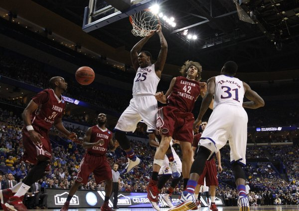 Kansas forward Tarik Black pounds home a dunk against Eastern Kentucky during the second half on Friday, March 21, 2014 at Scottrade Center in St. Louis.