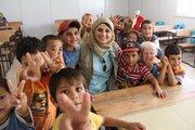 Kansas University alumna and Syrian activist Jomanna Qaddour with Syrian children on a visit to Zaatari Refugee Camp in Amman, Jordan, last summer.