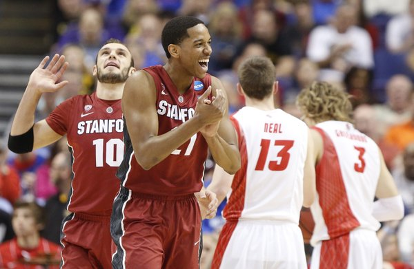 Stanford guard Anthony Brown, front, claps his hands after a New Mexico foul on Friday, March 21, 2014 at Scottrade Center in St. Louis. At left is Stanford guard Robbie Lemons.