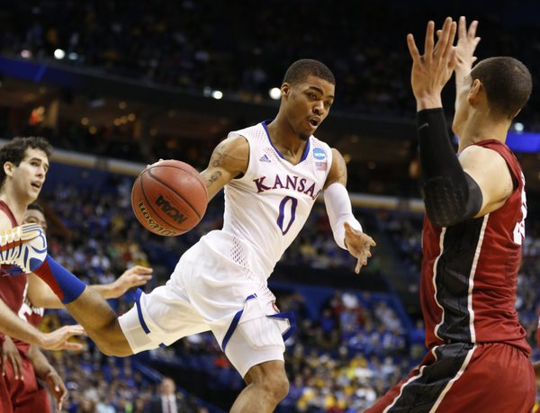 Kansas guard Frank Mason dumps a pass inside against Stanford during the first half on Sunday, March 23, 2014 at Scottrade Center in St. Louis.