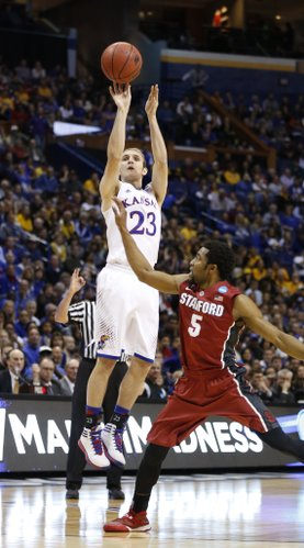 Kansas guard Conner Frankamp puts a three over Stanford guard Chasson Randle during the first half on Sunday, March 23, 2014 at Scottrade Center in St. Louis.
