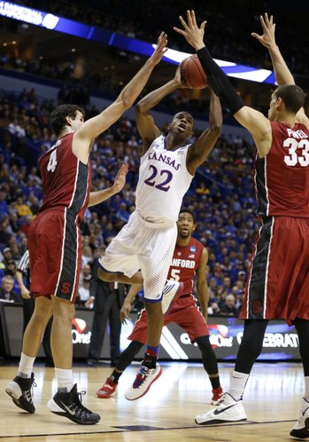 Kansas guard Andrew Wiggins puts a shot between Stanford defenders Stefan Nastic, left, and Dwight Powell during the first half on Sunday, March 23, 2014 at Scottrade Center in St. Louis.
