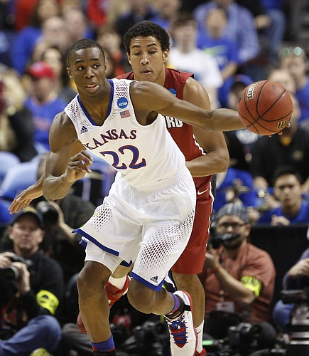 Kansas guard Andrew Wiggins heads up the court past Stanford forward Josh Huestis during the first half on Sunday, March 23, 2014 at Scottrade Center in St. Louis.