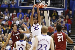 Kansas forward Landen Lucas dunks past Stanford forward Stefan Nastic during the second half on Sunday, March 23, 2014 at Scottrade Center in St. Louis.